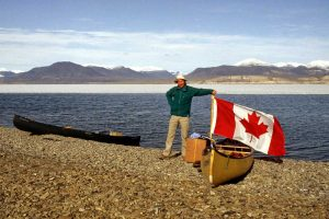 John Godfrey Raises Canadian Flag on Lake Hazen